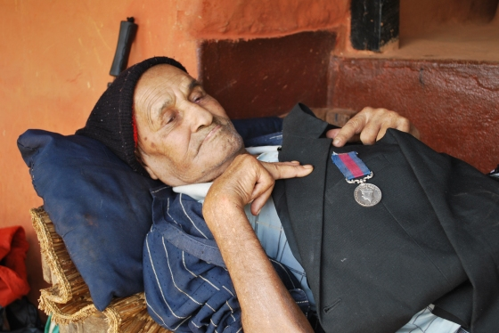 Welfare pensioner in the district of Syangja proudly showing his WWII bravery medal