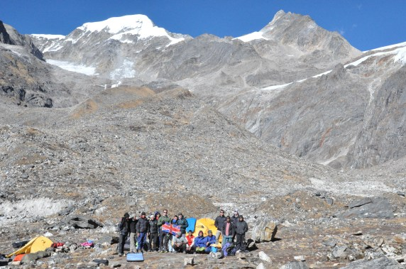 The team at Paldor base camp. Paldor (5928m) is the snowy peak in the background.