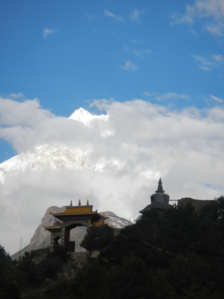 Mt Manaslu (8156m), eight highest mountain in the world, just visible through the clouds